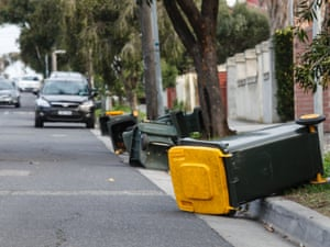 Bins are knocked over after wild winds in Melbourne on Tuesday
