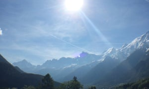 The sun shines on the Alps above Chamonix