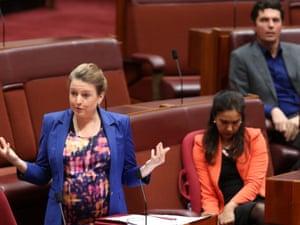 Western Australian Senator Louise Pratt bids farewell as she delivers her valedictory, with ALP senator Lisa Singh and Greens senator Scott Ludlam in the background.