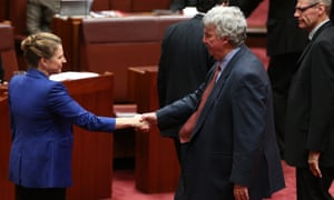 Western Australian senator Louise Pratt shakes hands with fellow outgoing conservative Nationals senator Ron Boswell from Queensland.