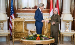 Kurdistan Regional Government President Massoud Barzani and US Secretary of State John Kerry talk before a meeting at the presidential palace in Irbil, the capital of northern Iraq's Kurdistan autonomous region.