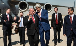 US Secretary of State John Kerry jokes with Fuad Hussein chief of staff at the presidency of the Kurdistan Regional Government on his arrival in Irbil.