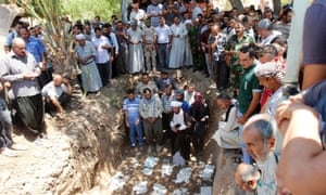 Mourners pray during a funeral for 15 Iraqi Turkmen Shia killed by militants in Tuz Khurmato.