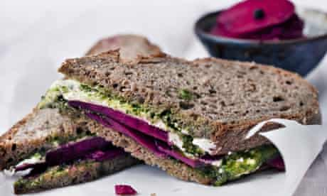 Goat's curd with crisp pickled beetroot sandwich on linen tablecloth