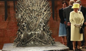 Queen Elizabeth has a good look at the iron throne whilst Prince Phillip talk to Queen Cersei Lannister played by Lena Headey in the show