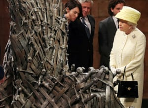 The Queen takes a closer look as Queen Cersei looks on.