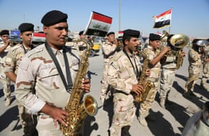 An Iraqi army band performs at the main recruiting center during a recruiting drive for men to volunteer for military service in Baghdad, Iraq, Tuesday, June 24, 2014.