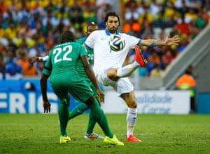 Ivory Coast's Souleyman Bamba watches Greece's Giorgios Samaras as he controls the ball.
