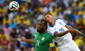 Didier Drogba of Ivory Coast and Jose Holebas of Greece clash as they both go for a header.