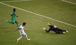 Greece's midfielder Andreas Samaris shoots and scores.