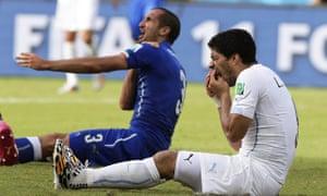 Italy's Giorgio Chiellini claiming he was bitten by Uruguay's Luis Suarez, right, in Natal