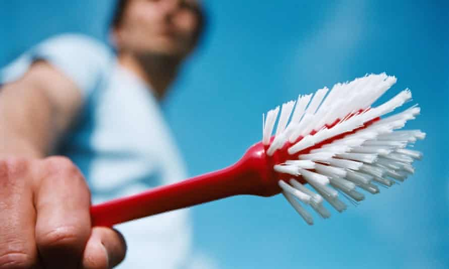 Man holding cleaning brush