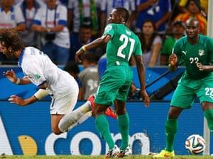 Ivory Coast's Giovanni Sio commits a foul on Greece's Giorgios Samaras.