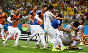 Greece celebrate the goal which takes them through to the knock-out stages.