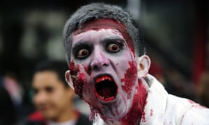 """A man dressed up as a zombie takes part in a """"Zombie Walk"""" at the Revolution Monument in Mexico City on November 3, 2012."""