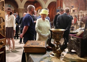 Queen Elizabeth II meets some of the costume and prop designers in the old Harland and Wolf paint room during their visit to the HBO TV series 'Game of Thrones' set in Belfast's Titanic Quarter in Belfast, Northern Ireland.