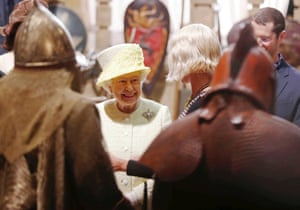 Britain's Queen Elizabeth looks at costumes and props as she visits the set of the television series Game of Thrones, in the Titanic Quarter of Belfast, Northern Ireland