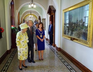 Belfast Lord Mayor Nichola Mallon shows Queen Elizabeth II and Prince Philip, Duke of Edinburgh the painting 'Battle of the Somme' by J P Beadle at City Hall for a lunch in honour of The Queen and Duke of Edinburgh celebrating the 'Best of Belfast' in Belfast, Northern Ireland.