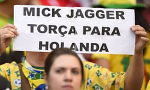 A supporter holds a placard urging Rolling Stone singer Mick Jagger to support Holland.