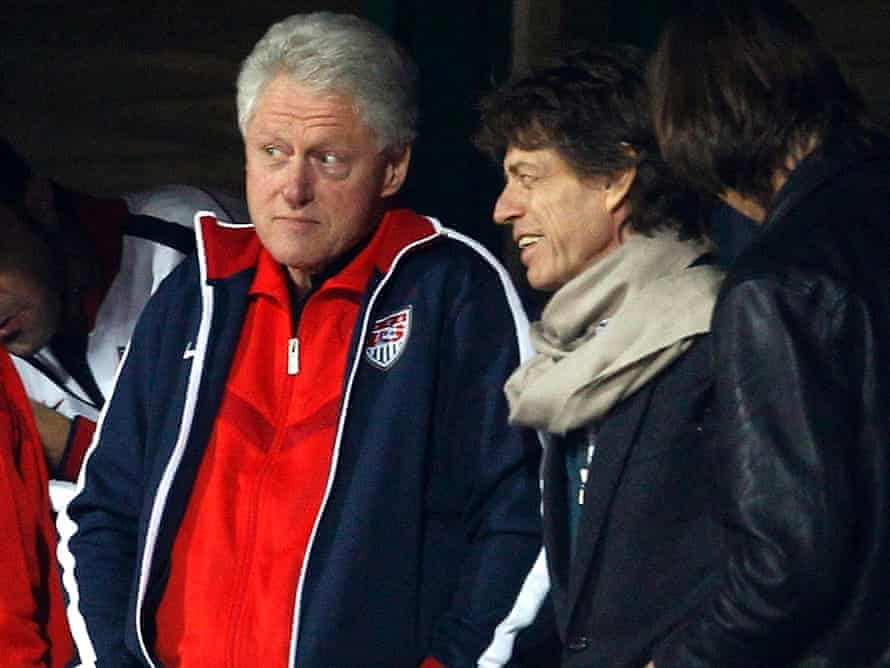 Mick Jagger helps Bill Clinton support the US in their  2010 World Cup match against Ghana. The Americans lost.