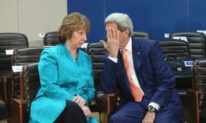 US Secretary of State John Kerry talks to European Union foreign policy chief Catherine Ashton.