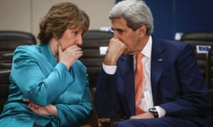 Ashton chats to Kerry at the start of a Nato Foreign ministers council in Brussels.