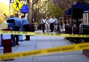 Washington police investigate a shooting near the entrance to the Smithsonian National Zoo in April.