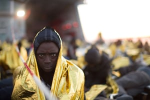 African asylum seekers rescued off boats and taken aboard an Italy navy ship, 8 June.