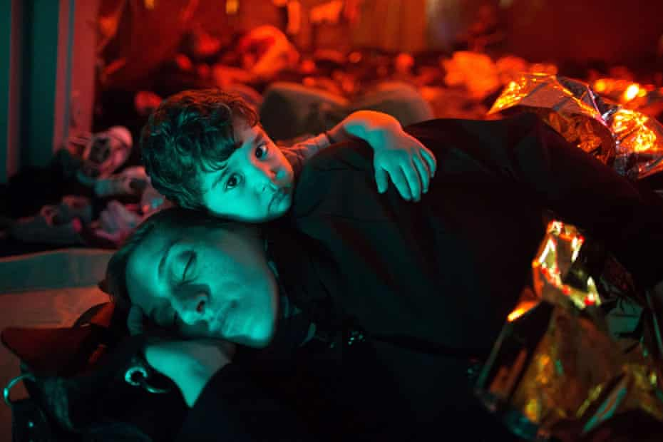 A mother and child on a Italian navy ship after being rescued from a fishing vessel carrying 443 Syrian asylum seekers, 5 June.