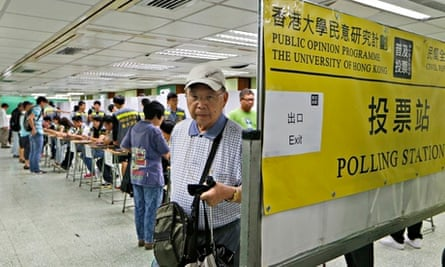 People vote in an unofficial referendum on democratic reform in Hong Kong