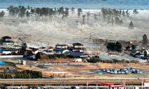 Tsunami waves hit homes in Natori