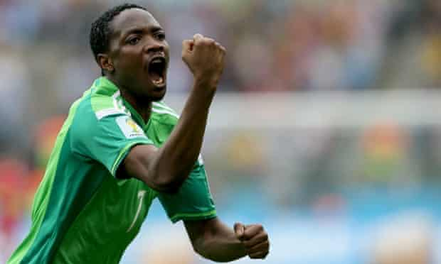Ahmed Musa of Nigeria celebrates after equalising.
