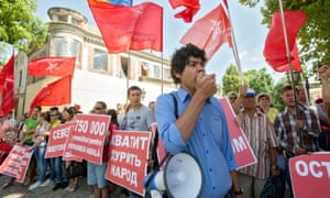 Supporters of the Socialist Party of Moldova protest against the EU deal outside the US embassy in Chisinau.