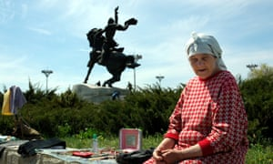 An elderly woman sells goods in central Tiraspol, the capital of the self-proclaimed republic of Transnistria.