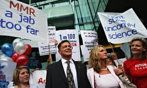 Dr Andrew Wakefield and his wife, surrounded by supporters, arrive for a GMC hearing