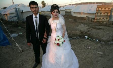 Real lives go on amid the chaos: Wedding of Syrian-Kurdish couple Jvan Khaled and Shekha Khaled (R) at the Quru Gusik (Kawergosk) refugee camp in northern Iraq