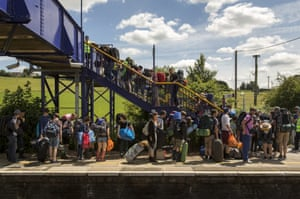 Festival goers arrive at Castle Cary station.