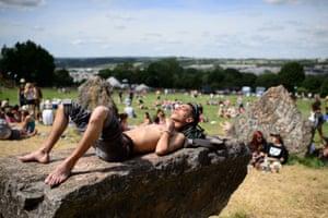 Festivalgoers enjoy the sunshine.