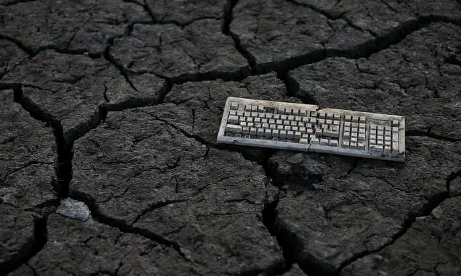 A computer keyboard sits on dried and cracked earth that used to be the bottom of the Almaden Reservoir  on January 28, 2014 in San Jose, California.