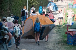 Festival goers arrive with their tent.