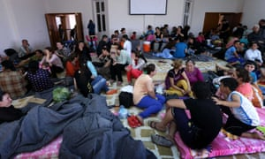 Iraqi Christian families fleeing the violence in the village of Qaraqush, about 30 kms east of the northern province of Nineveh, are pictured upon their arrival at a community center in the Kurdish city of Irbil.