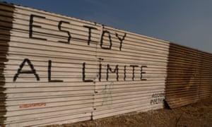Graffiti on the border fence at Tijuana