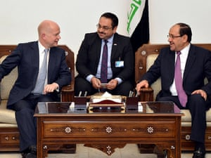 Foreign Secretary William Hague travelled to Baghdad for talks with Nouri al-Maliki as the Iraqi prime minister welcomed cross border Syrian air strikes against Isis insurgents.