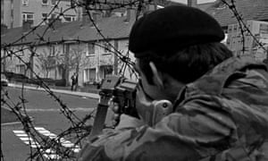 A British soldier aims his rifle on a suspect in the republican Ballymurphy estate in west Belfast.