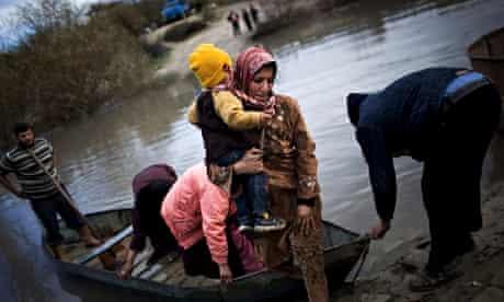 Refugees flee to Turkey via the Orontes River