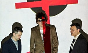 Preaching the Euro-message … Sean Moore, Nicky Wire and James Dean Bradfield with a projected artwor