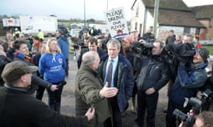 Environment Secretary Owen Paterson (centre) visiting Northmoor Pumping Station in Somerset on January 27, 2014. A new plan to deal with a flood-hit area of south-west England will be drawn up within six weeks, Paterson announced as he was confronted by residents angry about the perceived lack of action from officials to tackle the problem.