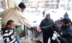 Members of Detroit 300 work with the police to bring some festive spirit to a poorer area of the city after a drugs raid.