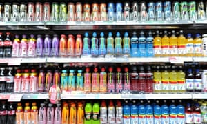 Fizzy drinks on a shelf on display at a supermarket.