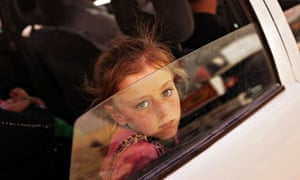 A child waits in Khazair to get into a camp for Iraqis displaced by Isis's advance into Mosul